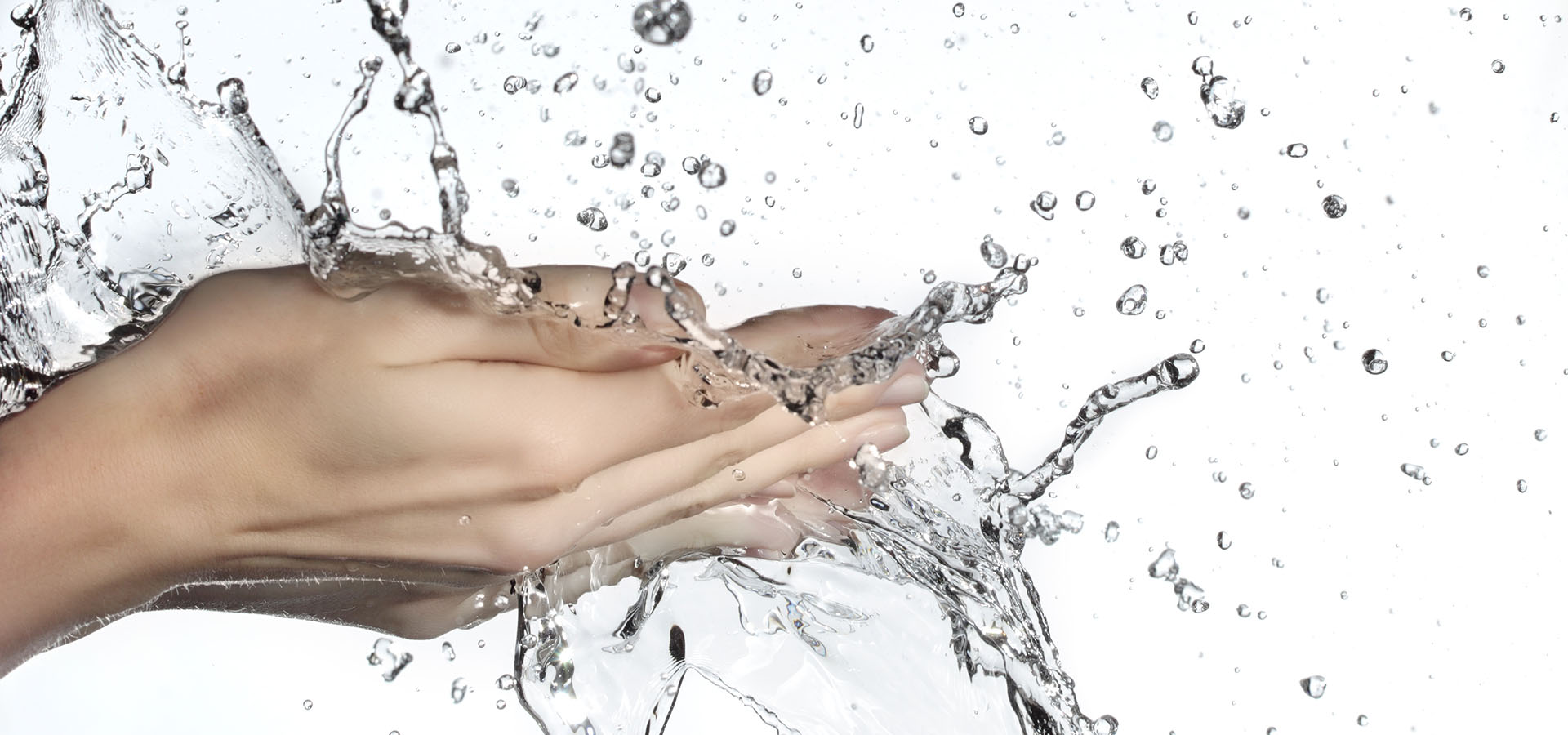 Hands and splashing water on white background.