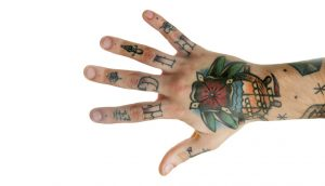 hand with ugly tattoo's