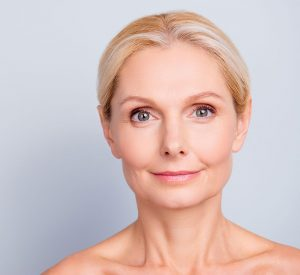 Middle aged woman's face with great skin tone.