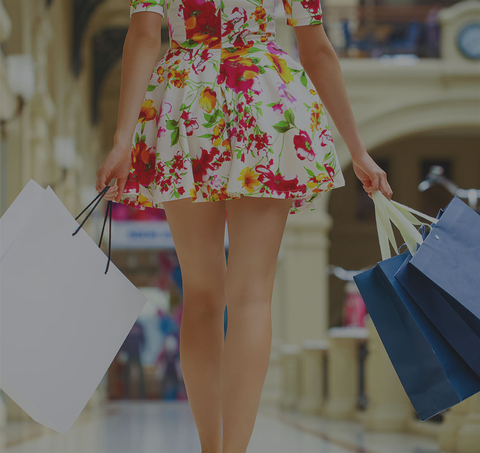 Female with shopping bags walking through mall