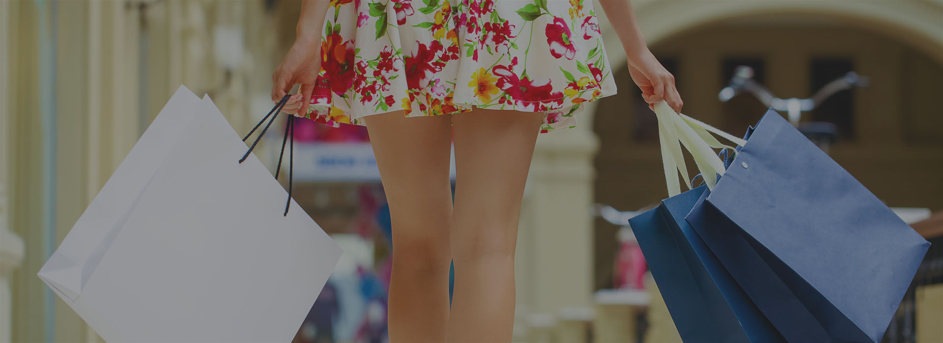 Female with shopping bags walking through the mall.