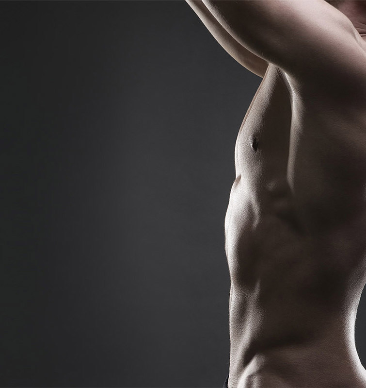 side view of naked male torso with great definition.