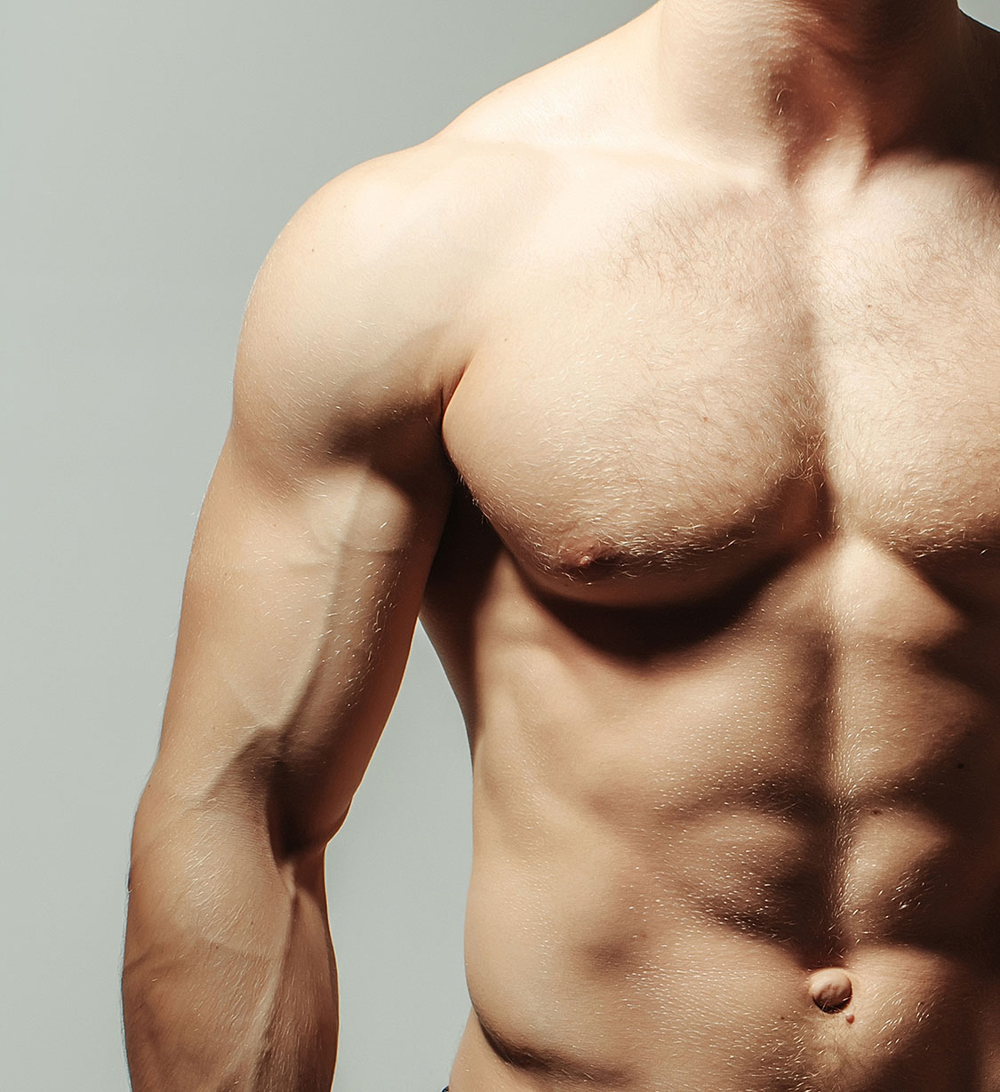 Young mans muscular chest and left arm
