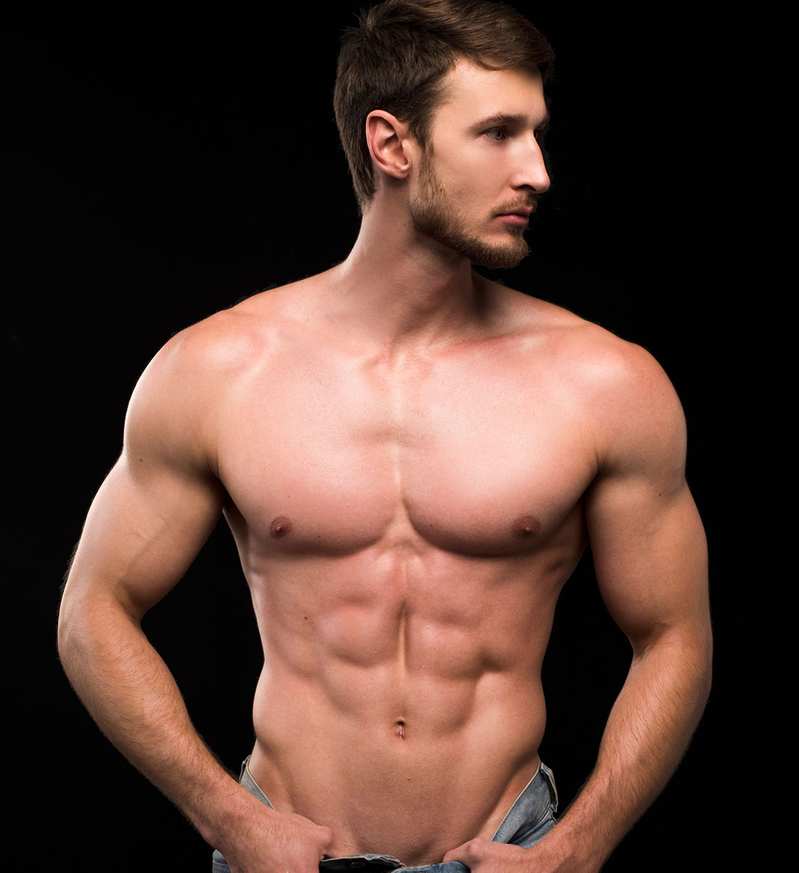 Young handsome mans upper muscular bare torso and face