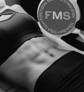 Young womans defined abs and tesla former applicator and